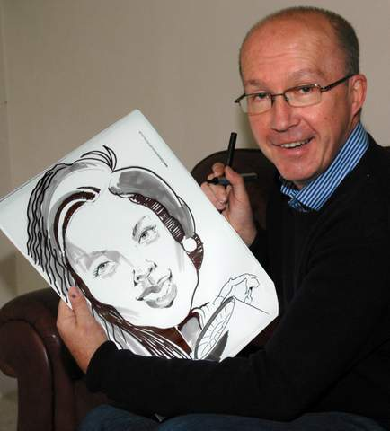 Caricaturist Paul with one of his portrait sketches