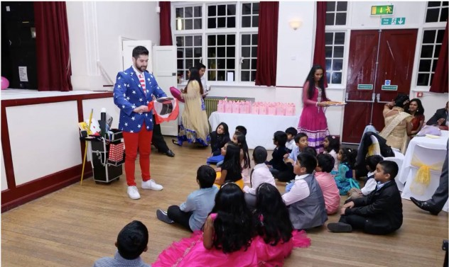 Magic Tony entertains children by performing loads of magic tricks.