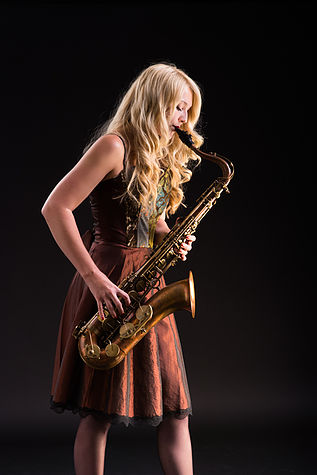 Saxophonist Laura is trained classically in both saxophone and piano.