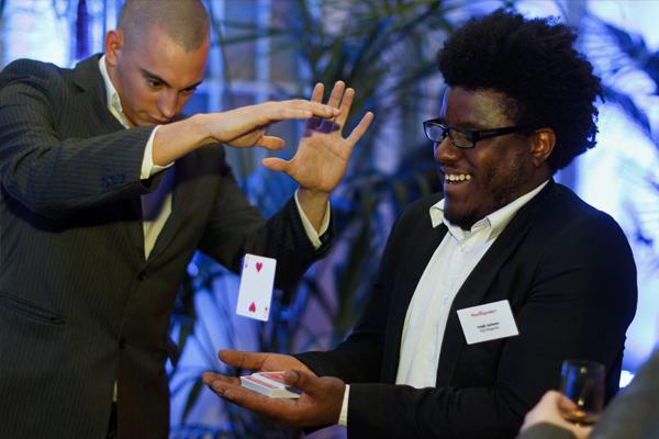 Magician Matt performs his close up magic at a corporate event.